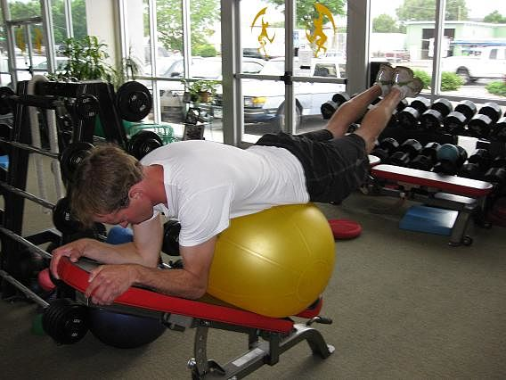 Man on fitness ball