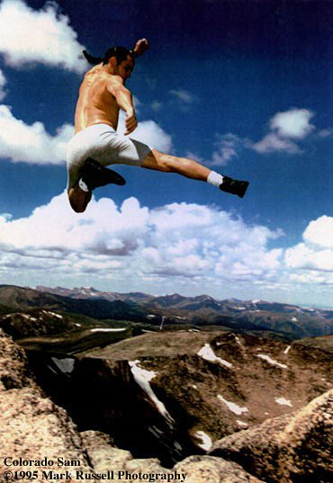 Sam Iannetta jumping in the mountains